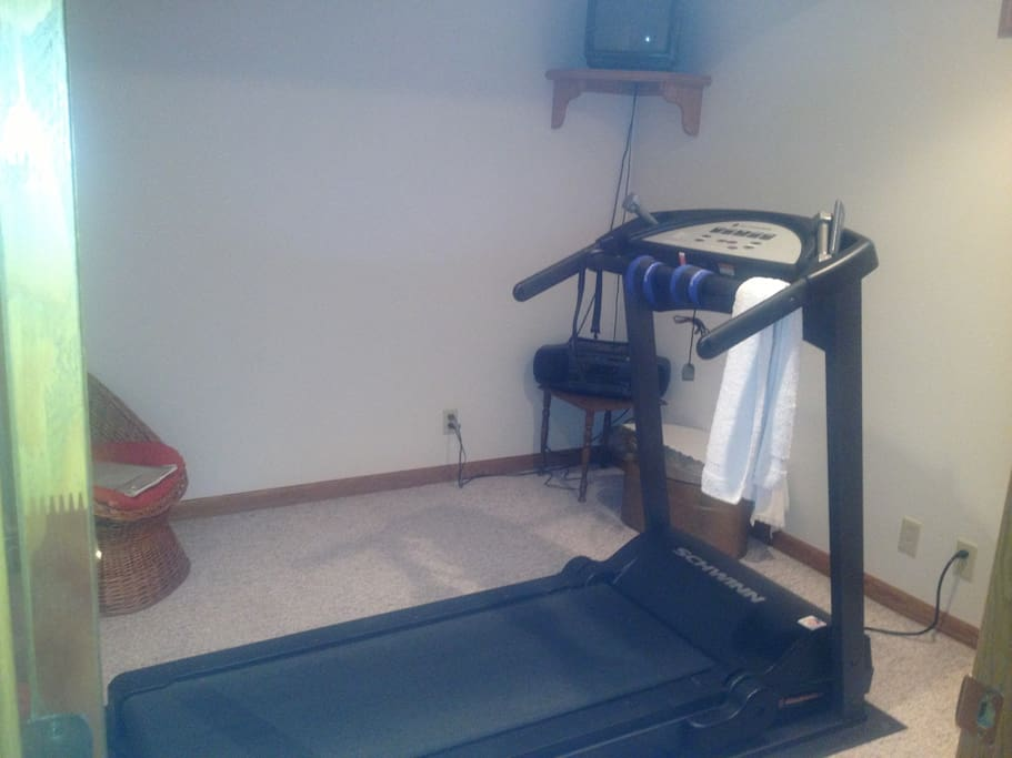 Exercise room with TV and free weights