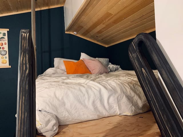 Sleep cozy in the loft with 4 pillows, clean white sheets, a reading light, and a plug for your device.