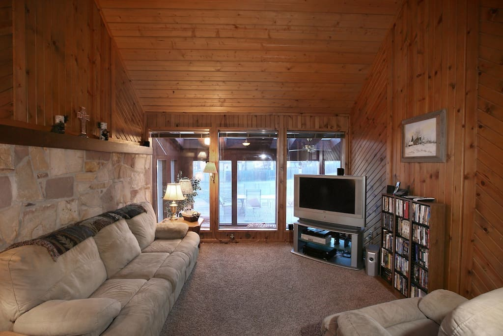 Living Room w/ comfortable sofa-sleeper, recliner, 50in HD TV w/ Streaming Subscription.
