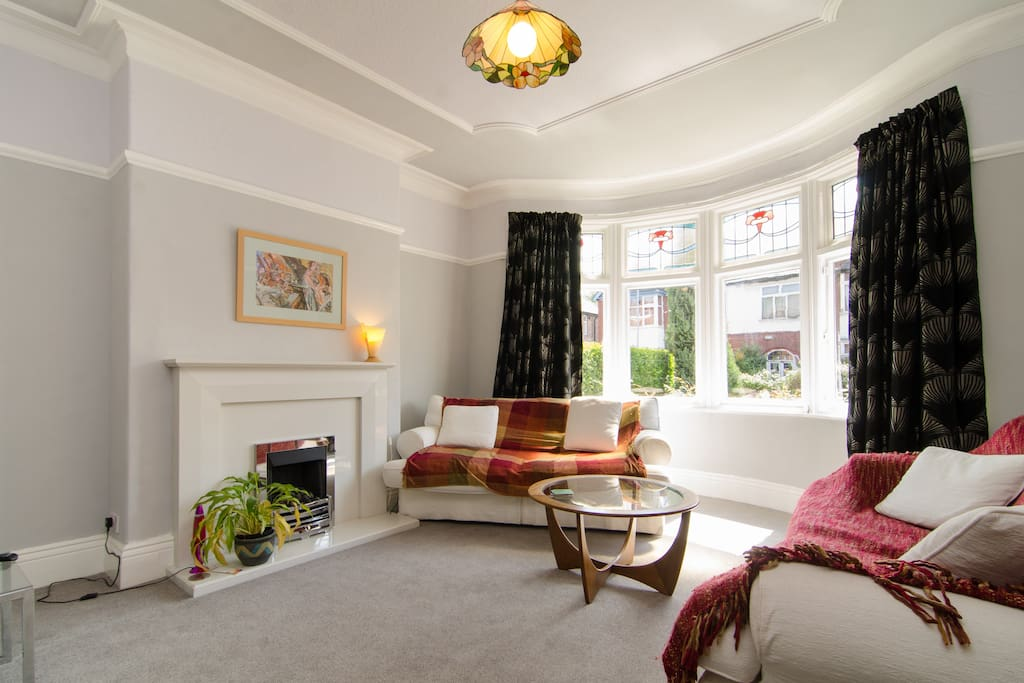 Sitting room with bay window facing the street