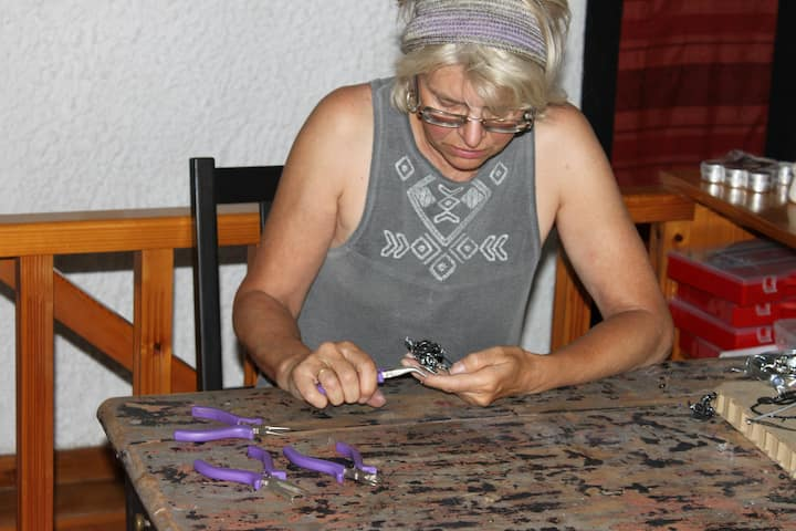 Sue working on a piece