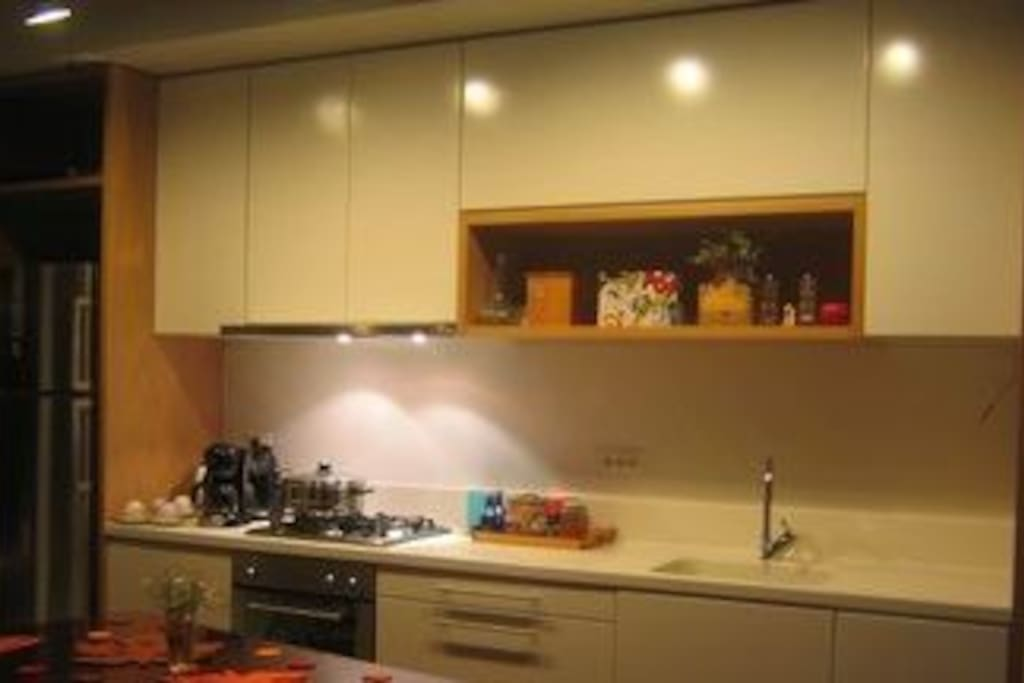 Fully equipped kitchen. Designer customer made furniture, beechwood.