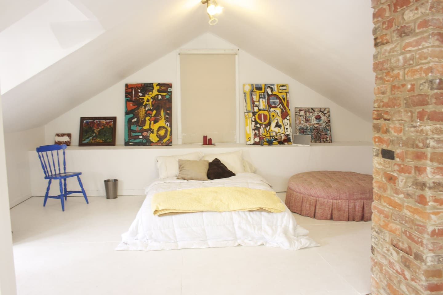 Comfortable and quiet bedroom with cool art and seating areas.