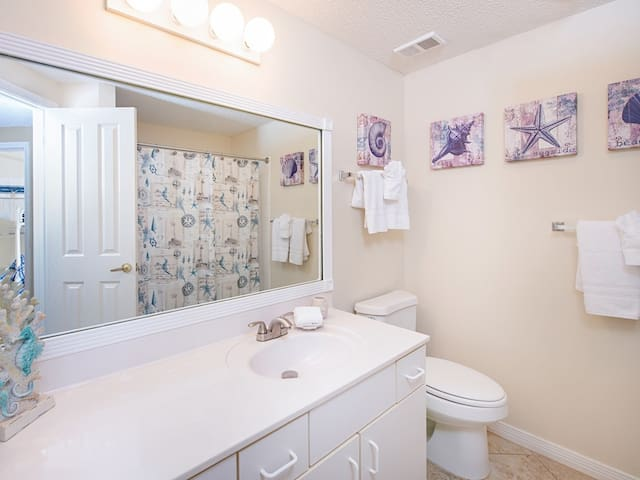 A 2nd bathroom with a tub/shower combination.