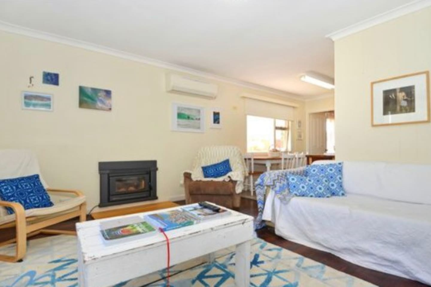 Shared space loungeroom - air con in summer, fireplace in winter, cheerful and cosy