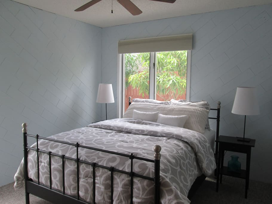 Master bedroom with a queen sized bed