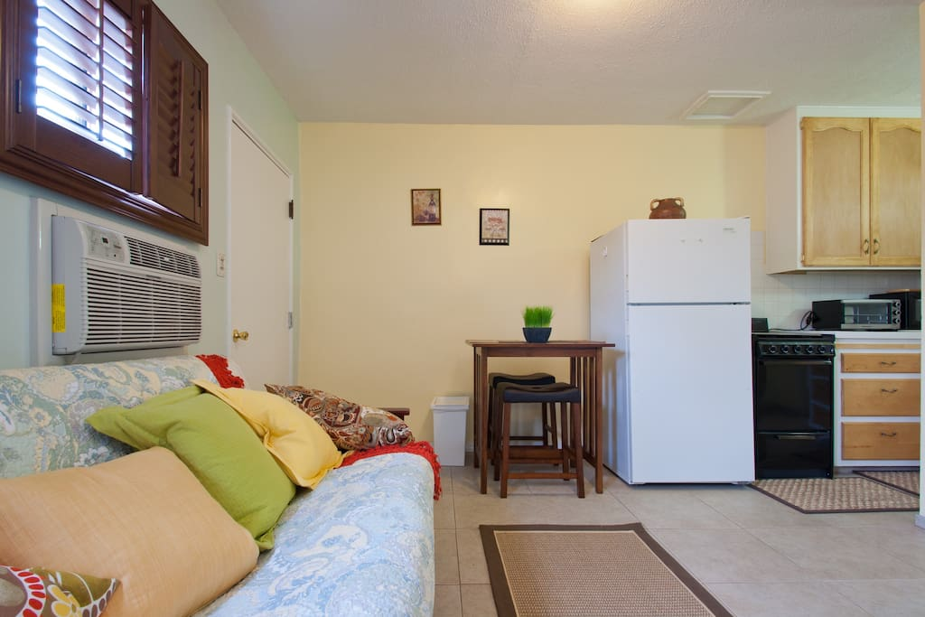 View fron the side of Bed/Sofa. Into the kitchen area. We have a Range, Stove, Toaster Oven, Microwave & Much more.
