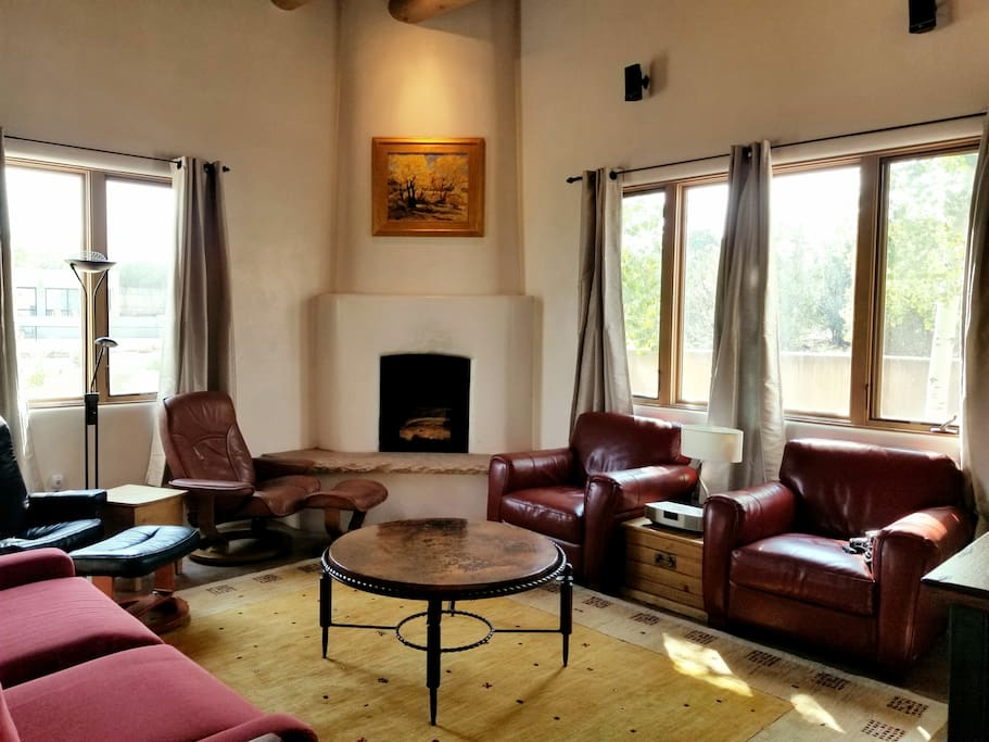 "Living room with fireplace, 55"" HDTV, plenty of room to comfortably sit"