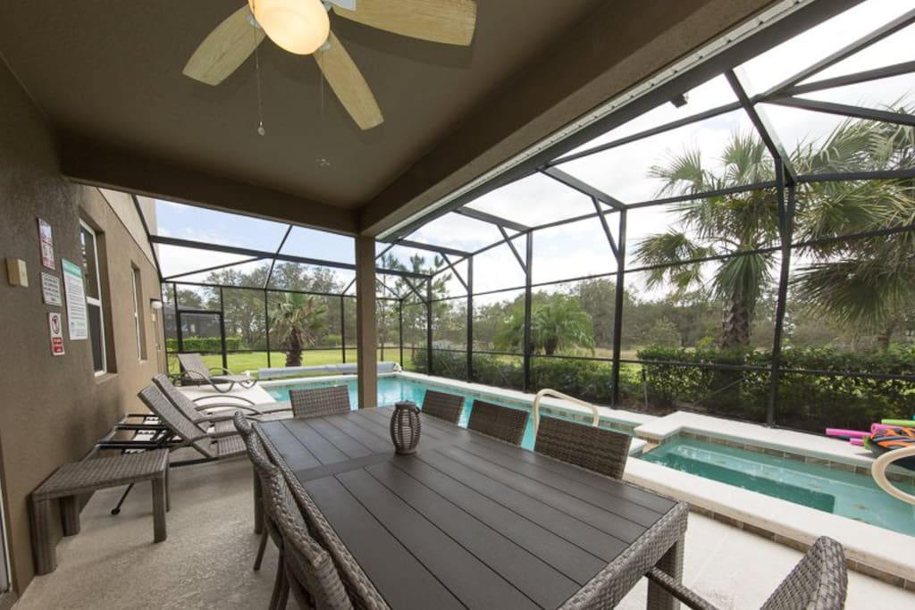 Contemporary seating and dining under the lanai
