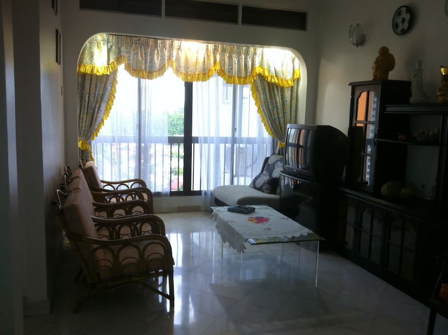 Living room is bright and sunny with a great breathtaking view of the island for the 14 floor
