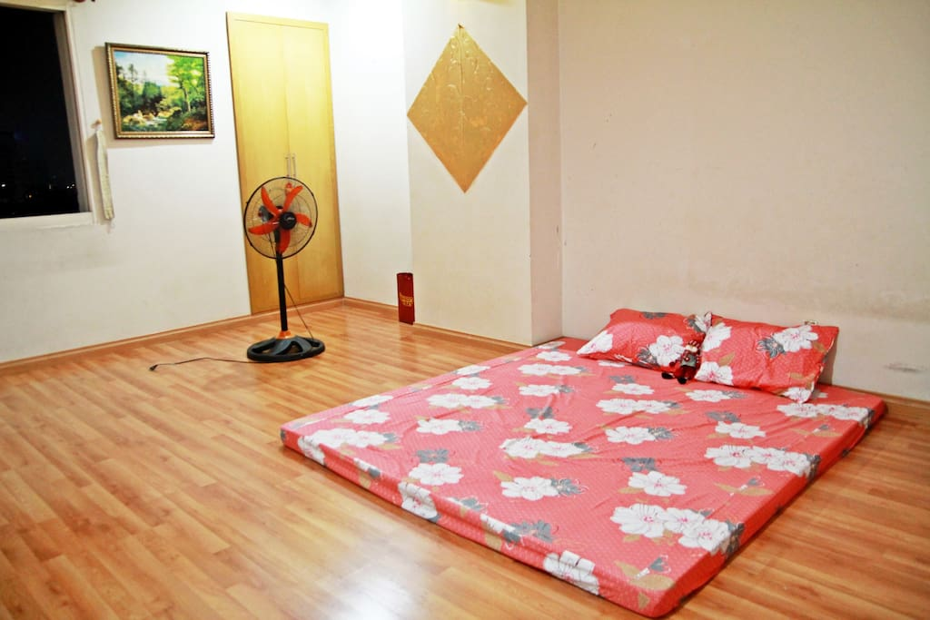 Big bedroom of 30m2. Has big window, 1 king size mattress, 1 closet, 1 fan and conditioner. Suitable for 2-3 people.