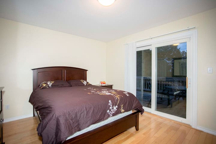 Bedroom with a queen bed and walk out to balcony. Bedroom also has an en suite