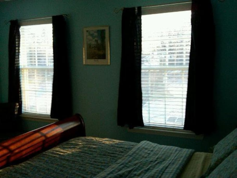 This southwest corner  bedroom ,receives dappled sunshine from outdoors.  In summer, two maple trees provide shade.