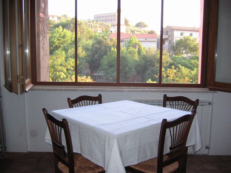 Comfortable dining table for four adjoining the kitchen