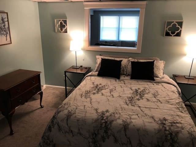 Bedroom has a window to allow natural light from common area with blackout blind to prevent incoming light.