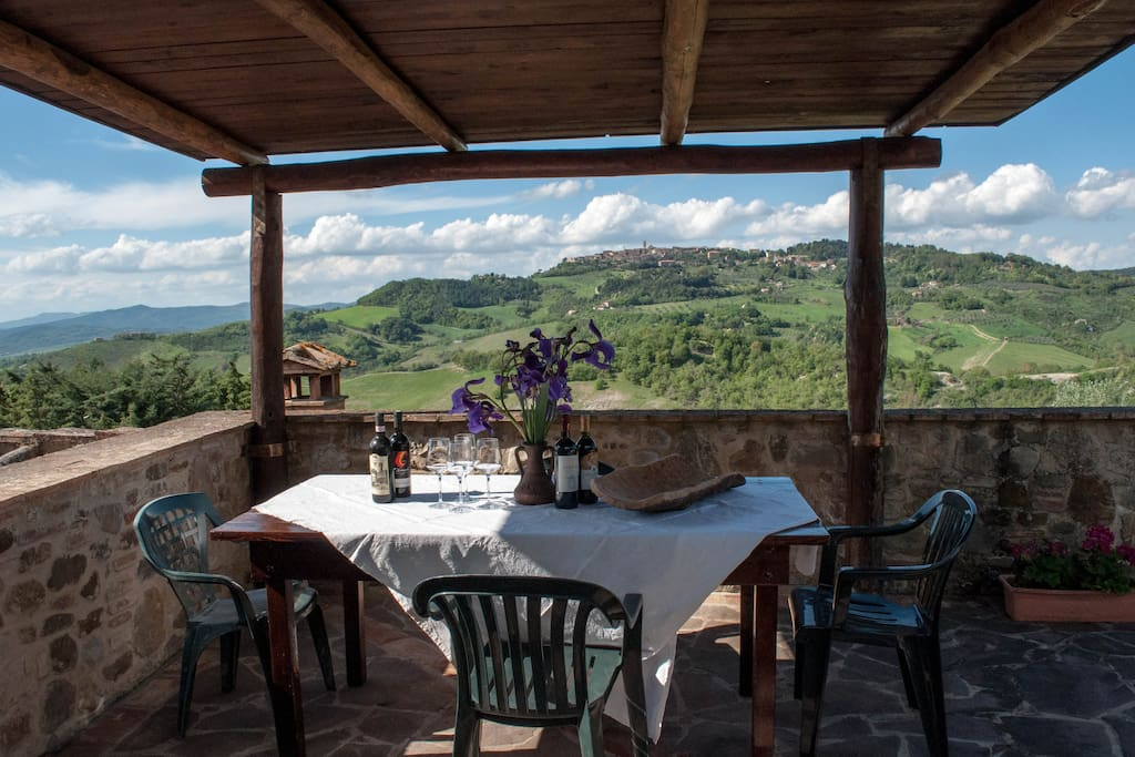 Terrace with views over the medieval village and the valley of Radicondoli