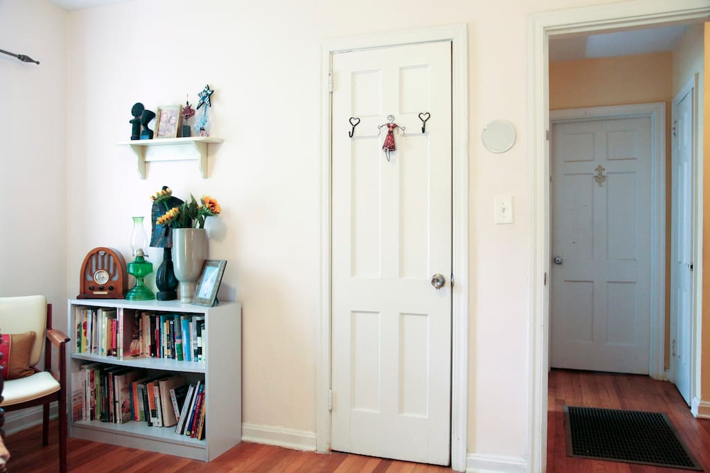 Plenty of books to read, & your closet...the bathroom is just outside your door to the left