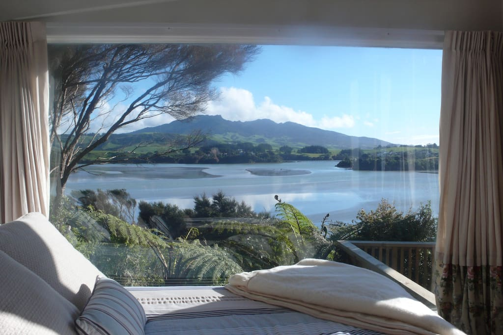 View of inner harbour and Mt Karioi from main bedroom in Cottage.