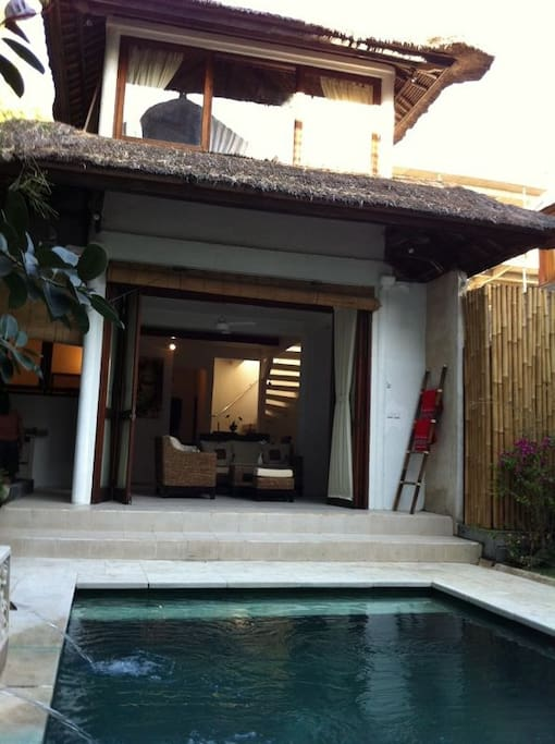 Jimbaran Beach Villa showing pool and living area