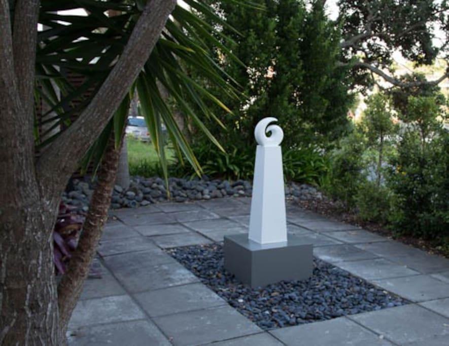 Koru sculpture at front