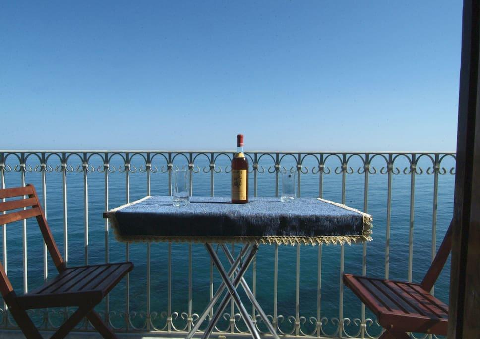 the balcony on the rocks of the sea