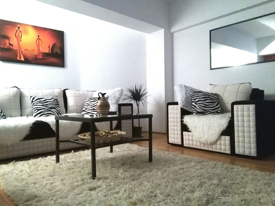 Cozy living room , decorated in African style , with carefully chosen decorative details, for a pleasant stay