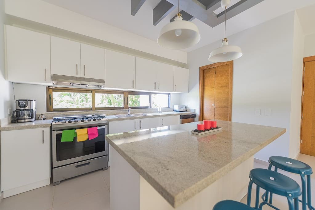 Fully equipped kitchen and laundry room
