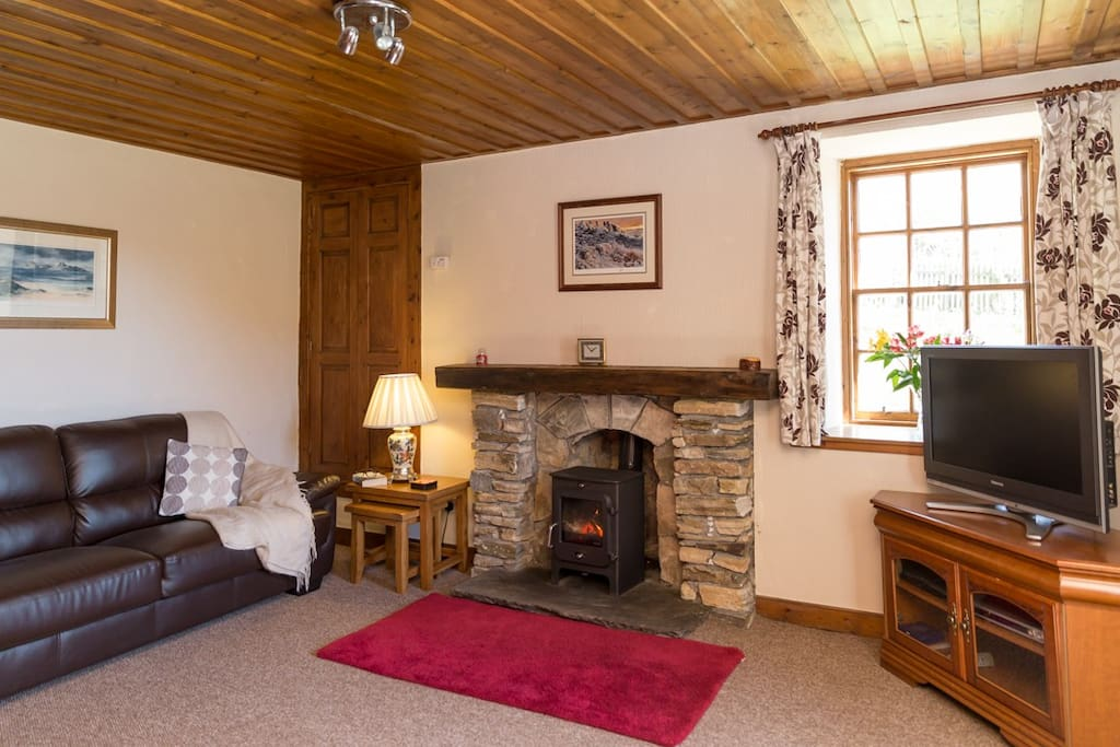 The cosy living room, the perfect space to relax after a day exploring.