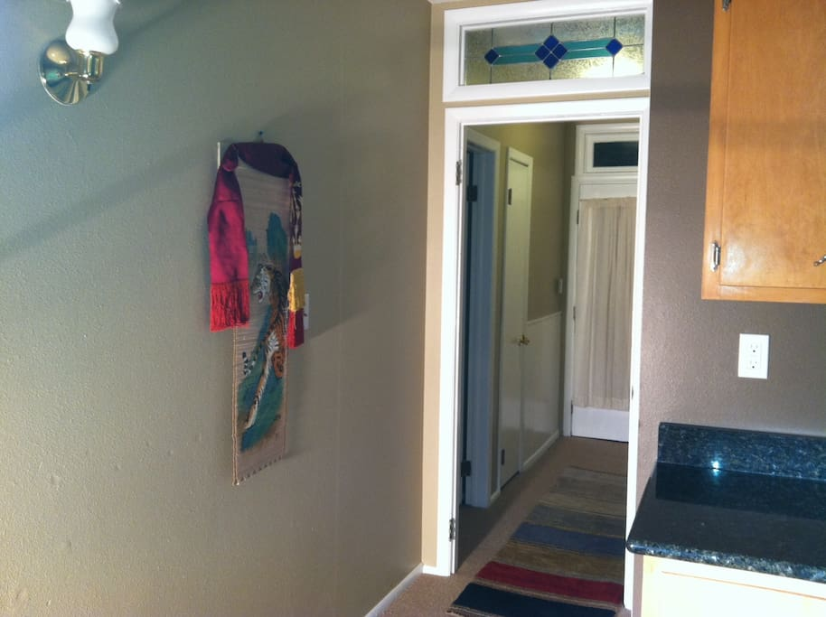Here you can see the hallway inside the apartment with stained glass transom