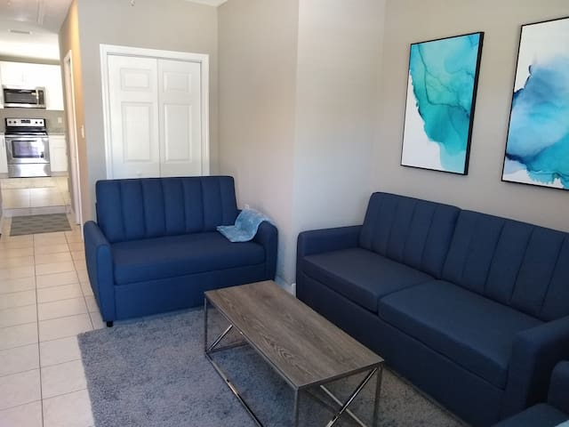 Living room #2 is also Bedroom #5 with 1 Queen size sofa/bed, & 2 Twin size sofa/beds. 1 single-size folding cot in closet. Large 70-inch flatscreen TV mounted on wall for your enjoyment!