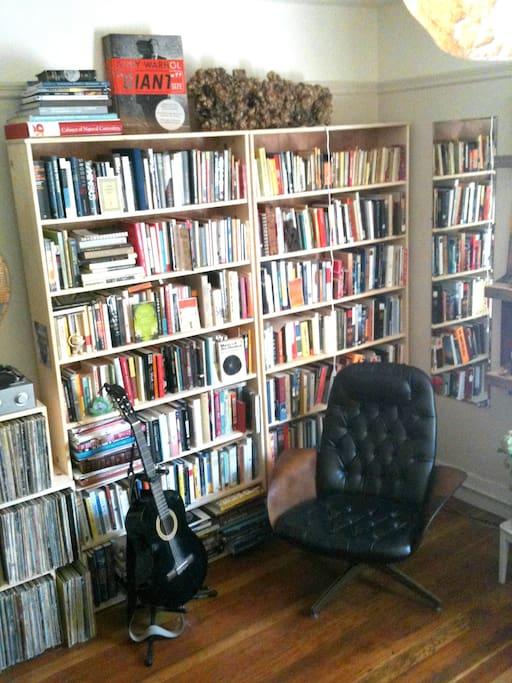 My grandfather's armchair with an endless choice of reading material.