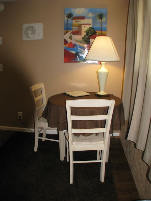 Eating area with lamp that will accommodate your laptop or cell phone charger.