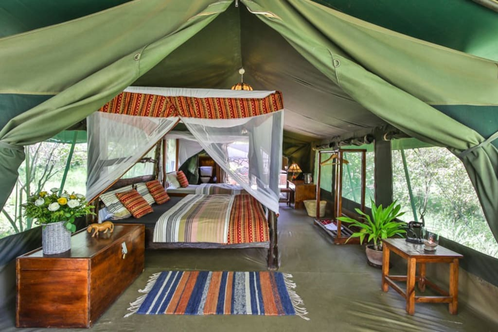 luxury tent with one double bed and one single bed // beautiful view to Talek river