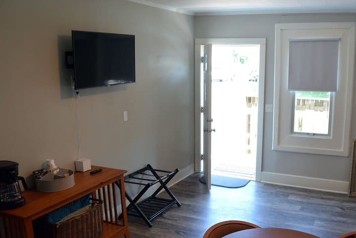 The Common Room at the Flybridge Suite is our largest and features coffee service, WIFI television, a full-sized sleeper couch, microwave, refrigerator and a table for four.