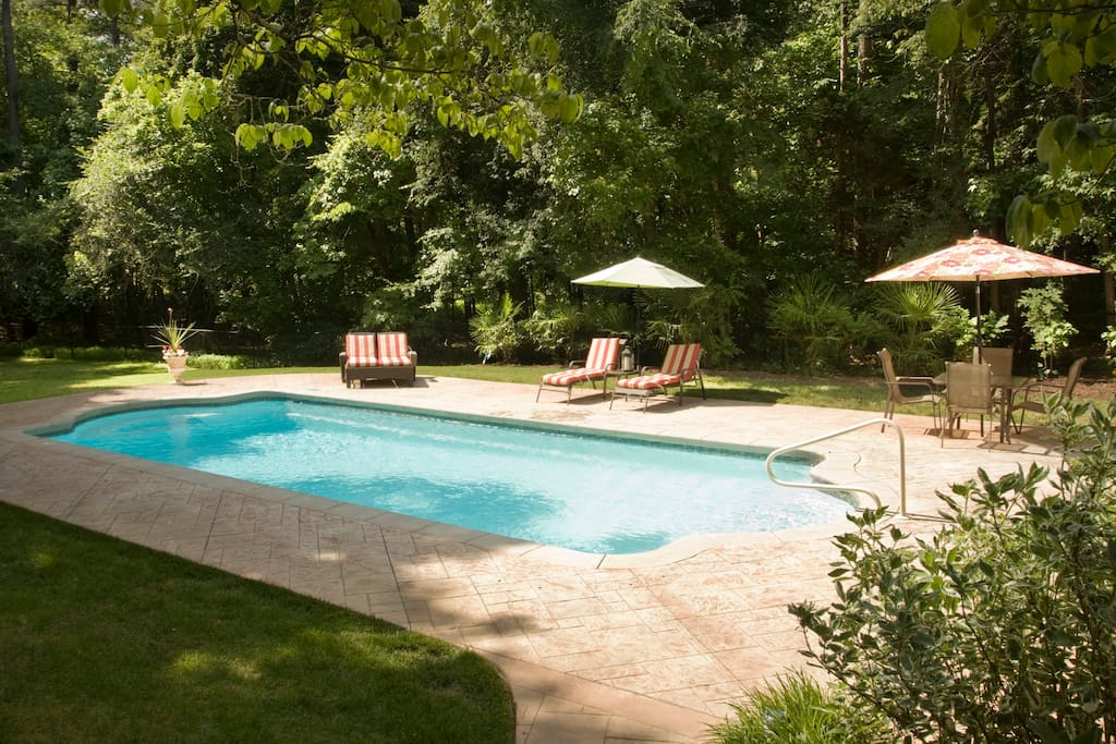 The pool area is equipped with cushioned lounge chairs and tables to comfortably seat your entire party.  Not pictured is a basketball hoop... a family favorite! And lots of pool inflatable lounges and toys.