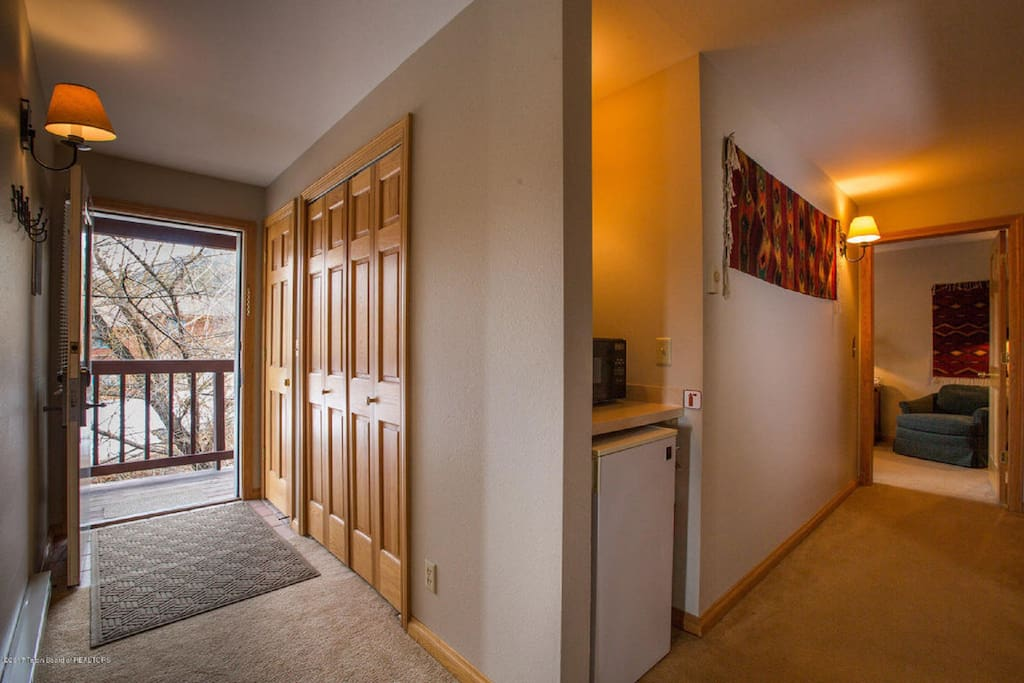 Unit B private access into the second story with 2 bedrooms, 2 full bathrooms, washer/dryer, and deck unit.