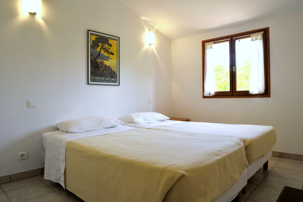 One of two twin-bedded bedrooms, upstairs.