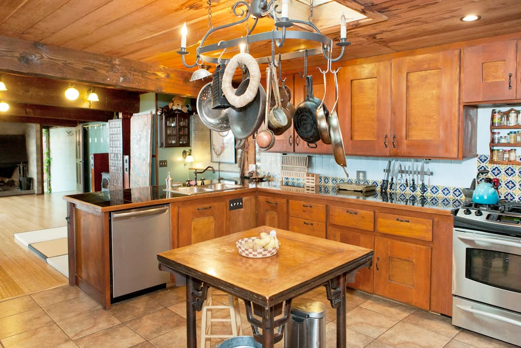 Kitchen is well stocked and spacious with bosch dishwasher, gas stove, and center island