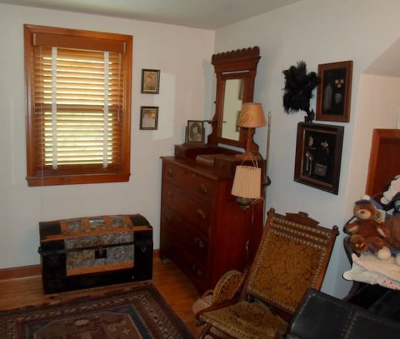 This is the other end of the south bedroom with a antique Victorian dresser.