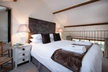 King size bed on mezzanine