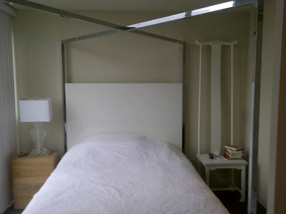 queen sized bed, 2 nightstands, bright with floor to ceiling windows