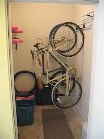 Secure storage closet for all your outdoor toys - bike hooks, ski/board racks