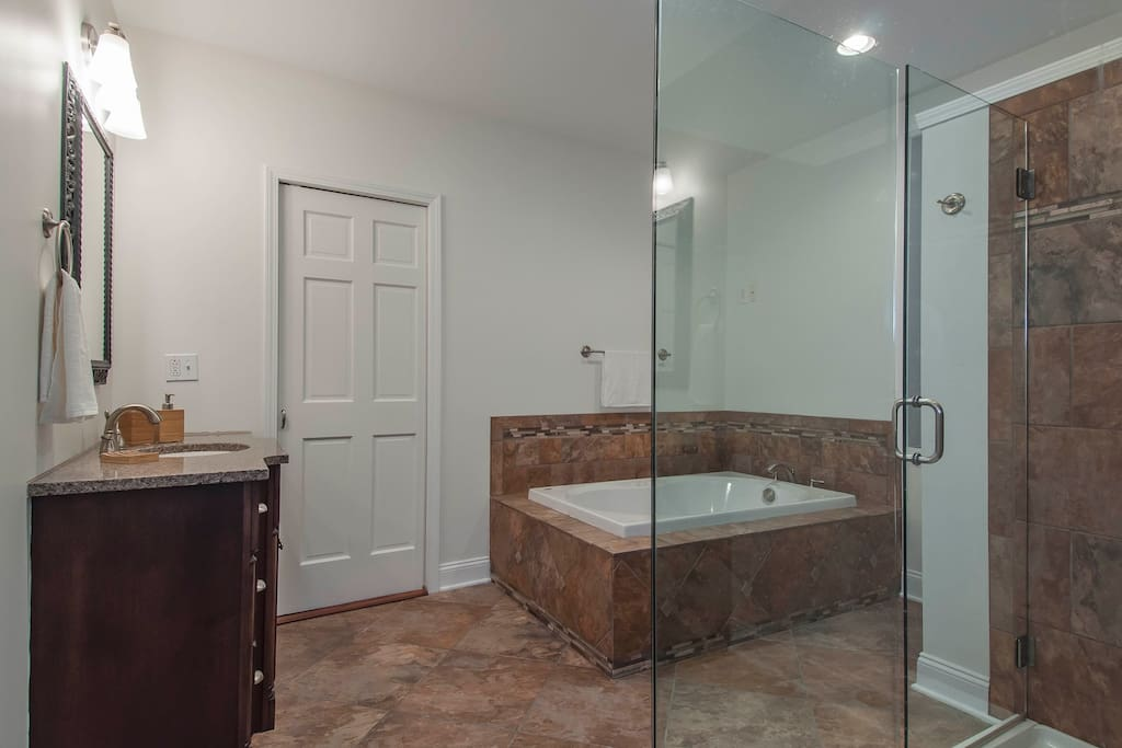 Luxurious tub, glass enclosed shower
