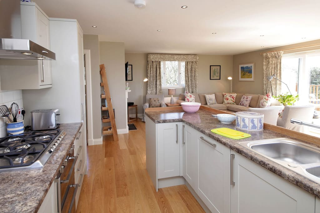 The open plan sitting room and kitchen with dining area