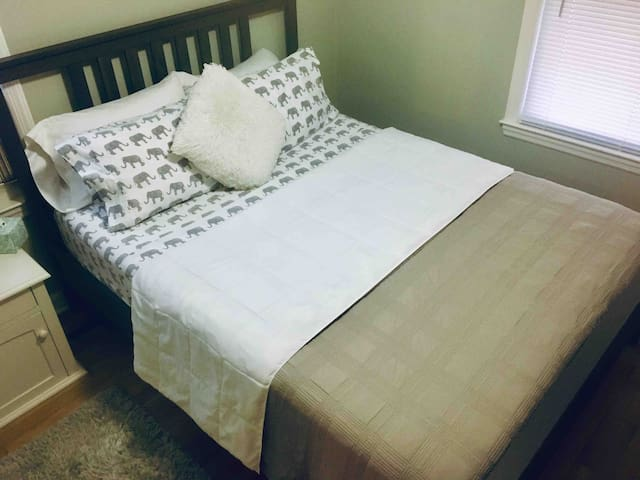 Front bedroom featuring a super comfy, high end nectar memory foam queen mattress. fully encased in a top of the line mattress protector, topped with a thick cotton mattress pad, and fitted with 100% cotton sheets+ a beautiful quilt and or comforter