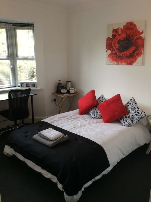 Clean, cosy and comfy room with workstation and tea and coffee making facilities.
