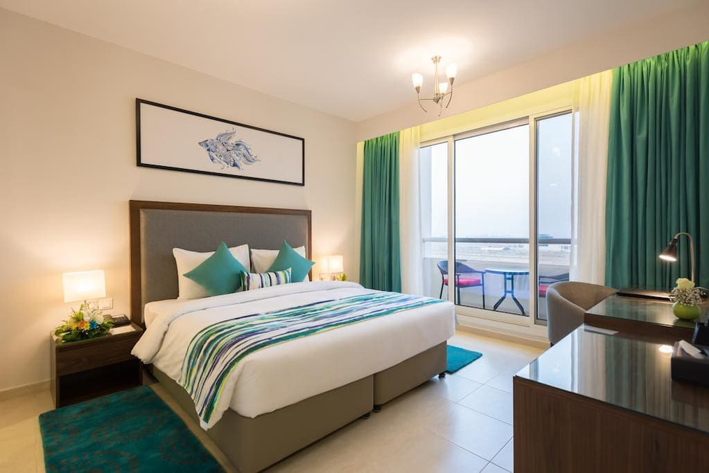 Comfy king bed in a deluxe room with sea view access