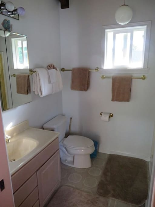 Bathroom off bedroom.  Has stall shower.