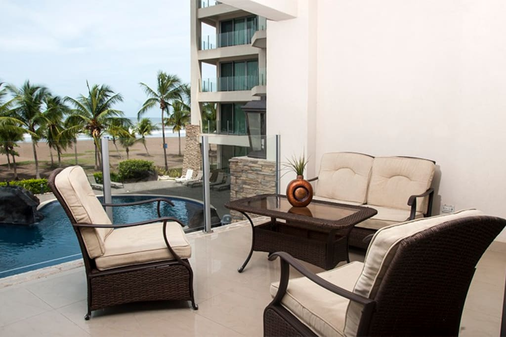 Private lounge balcony with pool and ocean views