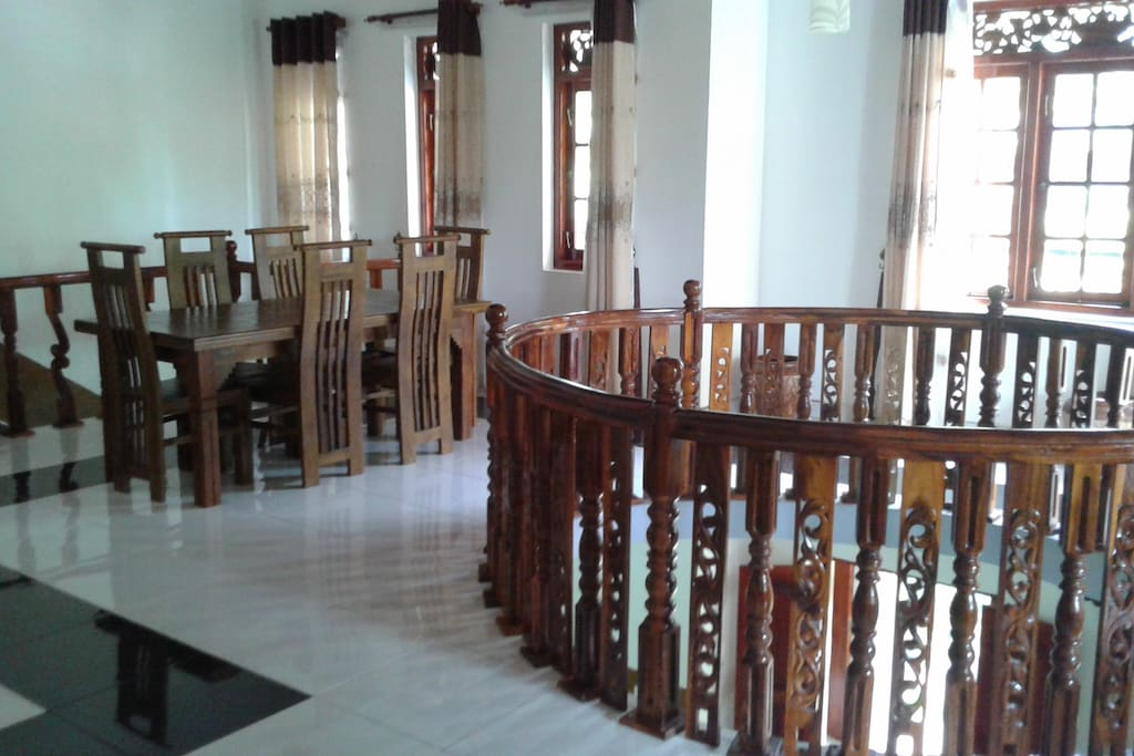 tabel and chairs on the first floor in the common area
